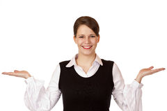 Happy woman holds both hands for advertisment Royalty Free Stock Images