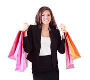 Happy woman holds in both hands bags with purchases Stock Images