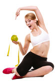Happy woman holds grapefruit and measurement tape stock image