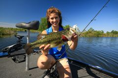 Woman Holding Large Mouth Bass Caught Fishing From Boat royalty free stock photos