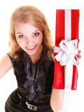 Happy woman holds red christmas gift box. Holidays. Royalty Free Stock Photo