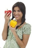 Happy woman holds two paprika Royalty Free Stock Photography