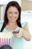 Happy woman at home with pop corn Stock Photos