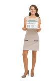 Happy woman homeowner showing scale model of house Royalty Free Stock Photo