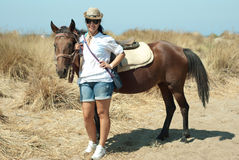 Happy woman with horse on beach Stock Photos