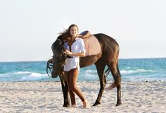 Happy woman with horse on sea background Royalty Free Stock Image