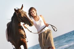 Happy woman with horse on sea background Royalty Free Stock Photography