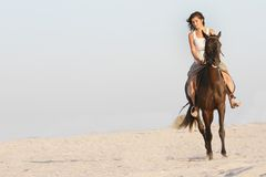 Happy woman with horse on sea background Stock Image