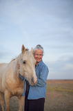Happy woman with horse Stock Images