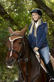 Happy woman horseback riding Stock Images