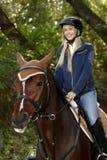 Happy woman horseback riding stock images