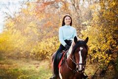 Happy woman on horseback Royalty Free Stock Image