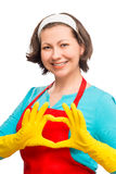 Happy woman housewife shows the heart of his hands Royalty Free Stock Photos