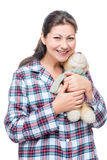 Happy woman hugging her beloved teddy bear on white. Background in studio Royalty Free Stock Photos