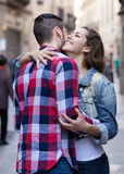 Happy woman hugging her male. Happy young women hugging her male friend outdoors Stock Images