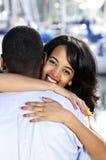 Happy woman hugging man Stock Photo