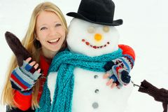 Happy Woman Hugging Snowman Outside in Winter Stock Images