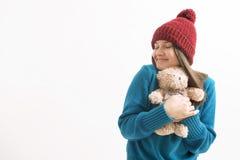Happy woman hugging a teddy bear Royalty Free Stock Photos