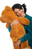 Happy woman huggy teddy bear Royalty Free Stock Photography