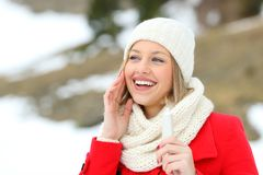 Woman hydrating face skin with moisturizer cream. Happy woman hydrating face skin with moisturizer cream in a snowy mountain in winter Stock Photography