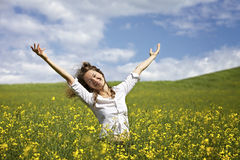 Happy Woman In Rapeseed Field Stock Photo