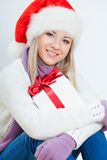 Happy Woman In Santa Hat Sitting Royalty Free Stock Images
