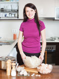 Happy woman with ingredients for  rice noodles with seafood Stock Images