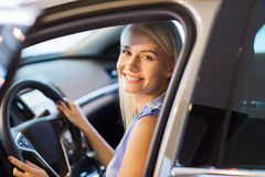 Happy woman inside car in auto show or salon Stock Photo