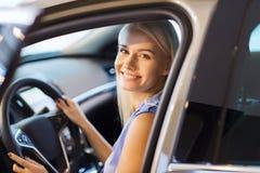 Happy woman inside car in auto show or salon Stock Photo