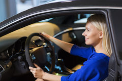 Happy woman inside car in auto show or salon Stock Image
