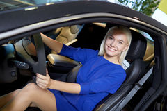 Happy woman inside car in auto show or salon Stock Photos