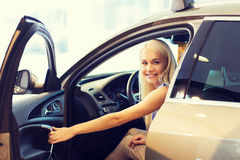 Happy woman inside car in auto show or salon Stock Photography