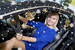 Happy woman inside car in auto show or salon Royalty Free Stock Photo