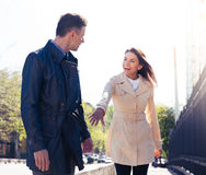 Happy woman inviting man outdoors Royalty Free Stock Images