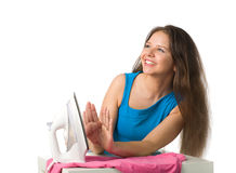 Happy woman with iron Stock Image
