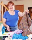 Happy woman ironing Royalty Free Stock Photos