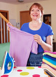 Happy woman ironing Stock Image