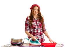 Happy woman ironing loundry isolated over white background.  Stock Photo