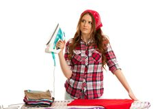 Happy woman ironing loundry isolated over white background.  Royalty Free Stock Images