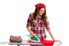 Happy woman ironing loundry isolated over white background.  Royalty Free Stock Photo