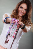 Happy woman with jewelry necklaces ring bracelets Royalty Free Stock Photos