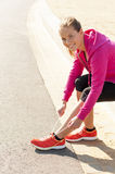 Happy woman jogger training in the park. Healthy lifestyle and p Stock Image