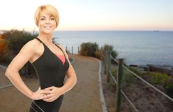 Happy woman jogging outdoors over beach background Stock Images