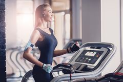 Happy women jogging on a treadmill for health. royalty free stock photos