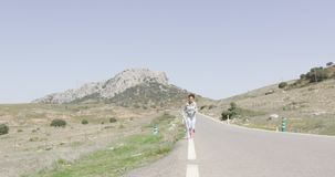 Happy woman jogging stock video