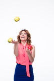 Happy woman juggles with apples Royalty Free Stock Images