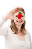 Happy woman with juicy fresh strawberry Stock Images
