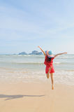 Happy woman Jump on the beach in Krabi Thailand Royalty Free Stock Photography