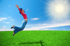 Happy woman jump in field Royalty Free Stock Photo