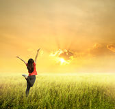Happy woman jump in grass fields and sunset Royalty Free Stock Photo